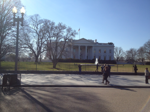 The White House in the sun.   New York Ave NW at 17th.