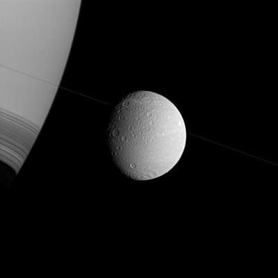 dendroica:  Saturn and its moon Dione appear in this image which was taken in visible green light at approximately 35,000 miles (57,000 kilometres) from Dione with the Cassini spacecraft wide-angle camera Picture: REUTERS/NASA/JPL-Caltech/Space Science Institute (via Pictures of the day: 3 February 2012 - Telegraph)
