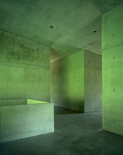subtilitas:  Valerio Olgiati - School, Paspels 1998. The interior wall are slightly angled, eliminating all right angles. The shift is so subtle (always within 5 degrees of being perpendicular) that while not necessarily noticeable at first, the misalignment heightens one's perception of the space. The room arrangement is also rotated from the first to the second floor; the stair leading you to another side of the circulation vestibule then on the lower floor, further disrupting the anticipated comprehension of the space.