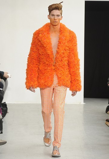 "acastewatson:  The Cult Belgian designers vivid tangerine colored ruffled coat just looks amazing. Great fashion show in Paris…  Oronte: I attended this fashion show with the king. He and i both agreed that this outfit was horrendous, although most of the outfits I could picture myself in (maybe a few sizes larger). Just to remind you if you need anything ""I'll mention it to the king, I have his ear of course, it's quite well known."""