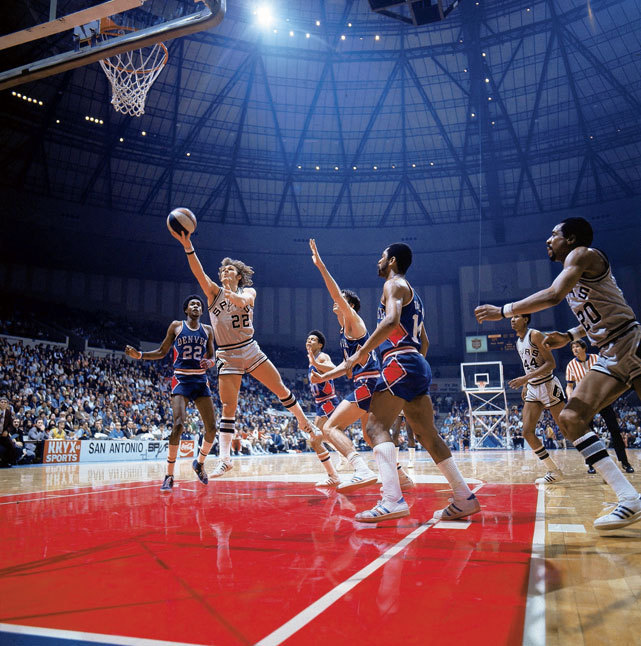 Spurs guard George Karl drives to the basket during a 1975 game against the Nuggets. (John Iacono/SI)  SI VAULT: The Spurs are making basketball fun in San Antonio (2.10.75)