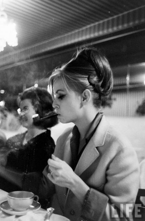 Woman smoking a pipe Photo by Ralph Morse, 1964
