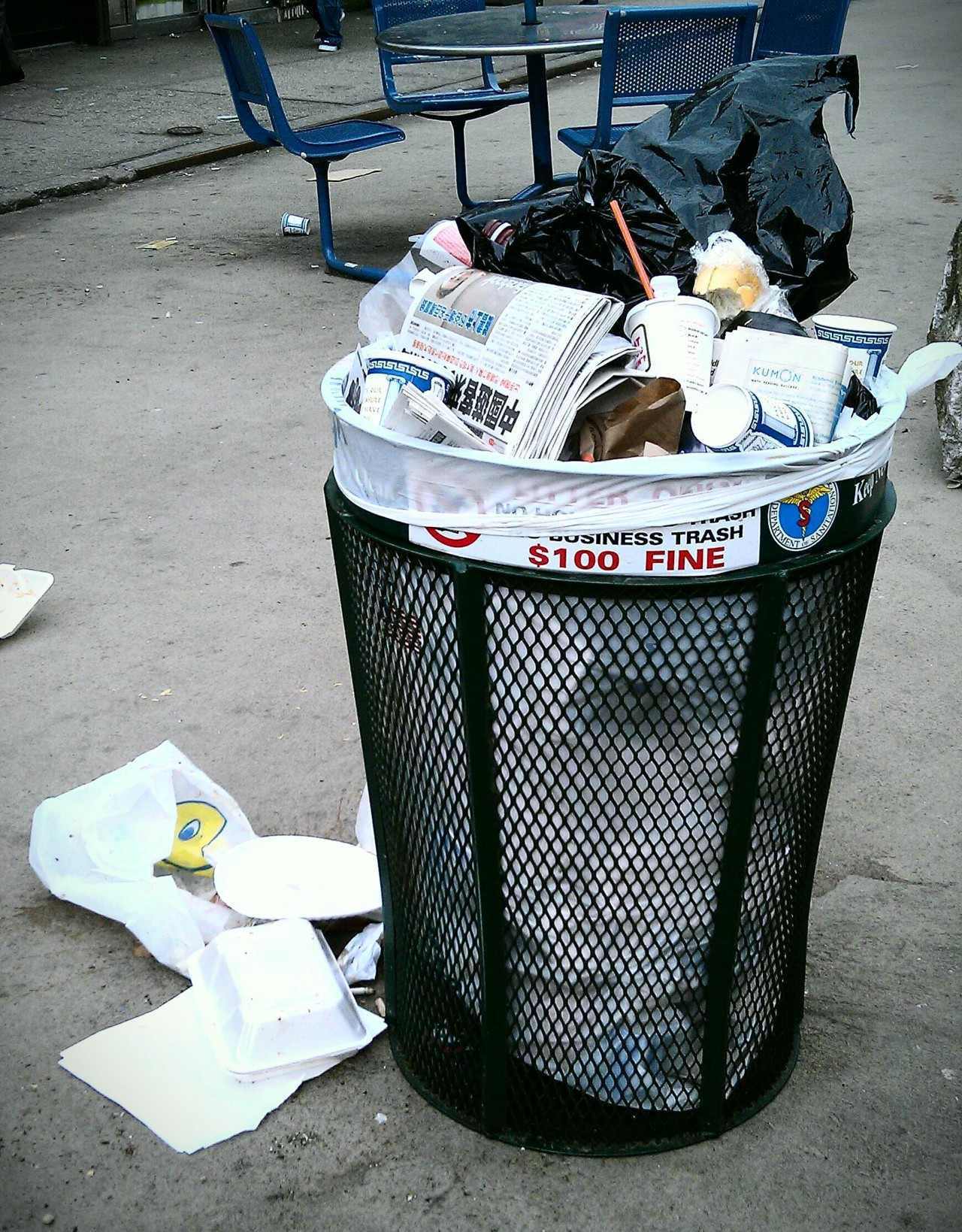 Trash can, 37th Road pedestrian plaza. From The Wall Street Journal:  As pedestrian plazas go, the one in the heart of Jackson Heights's commercial district isn't very attractive. OK, it's downright ugly.