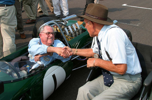 A handshake of a thousand words. Former rivals Jack Brabham & Stirling Moss shake hands during the 2004 Goodwood Revival. Jack is seated on the BT19 he used to run on during the 1966 F1 season.
