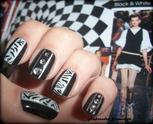 "Black&White… You'll need: Black nail polish 40, Flormar; Nail polish ""Frosted Champaign"" (05), Essence; nail art pen, Essence; crystals, Flormar. First of all, cover your nails with a base coat to protect them. Then paint them in black and let them dry. Next step is to make 2 vertical lines in the middle of each nail. Use special nail art pen, I used white one from Essence. Then just cover the space between 2 lines with white o champaign nails polish (if necessary make 2 covers). When they are dry (it's very important to wait!), make a zebra-like print with a black nail art pen (i also used the one from Essence). On the other nails you can use crystals for nail art, like i did. The last step is to protect nail polish, so use any top sealer. I've chosen ""better than gel nails"" top sealer, Essence. Enjoy! xx Follow my blog with Bloglovin"