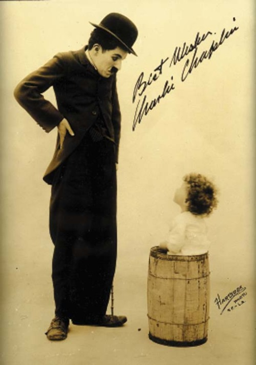 chaplininpictures:  Photo signed & inscribed by Chaplin. Rarely seen sepia photo by Hartsook, c. 1915.