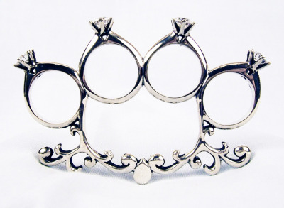 Katie Bauman 'til' death do us part' brass knuckle engagement ring.   It should go without saying, but I do not endorse or encourage any violent activity with this ring. It is intended solely as a unique statement piece in the form of jewelry.   $425.00 Via Kate Bauman