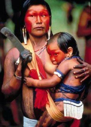 criminallyinnocent:  This is a Kayapó mother and child from the Brazilian Amazon Rainforest and while she might not get shit for breast-feeding in public, her entire people is being forcibly evicted from their ancestral homelands in order to make way for the massive Belo Monte Dam, which will make thousands of indigenous Brazilians homeless while simultaneously destroying a large part of what is commonly referred to as the lungs of the world.  In other words, western moral codes aren't currently this mother's biggest concern.