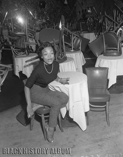Pretty Kitty Katt | 1953 on Flickr. Singer Eartha Kitt, seated in empty nightclub in Los Angeles, CA, 1953. Los Angeles Times photographic archive, UCLA Library. Copyright Regents of the University of California, UCLA Library. This work is licensed under a Creative Commons Attribution-Noncommercial-Share Alike 3.0 United States License. FIND US ON TWITTER | FACEBOOK | FLICKR  SUBCRIBE VIA  RSS | EMAIL