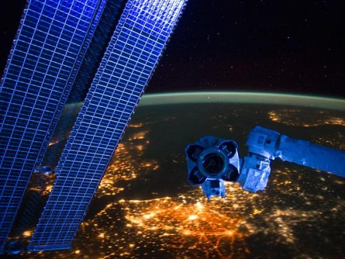 European Vista Photograph courtesy NASA Solar panels and the end of a robotic arm hover high above the city lights of Europe in a newly released picture taken from the International Space Station. The brightest lights at bottom center come from Belgium and the Netherlands, while the glow of the British Isles is partially obscured by the solar arrays at left.