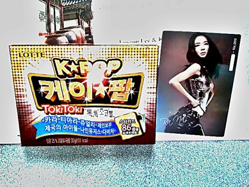 Korean candy that comes w/a random collectible Kpop Girl Group member card.  I got some girl named RaNa from 9Muses. Not too familar w/them.  My friend got Nicole from Kara. Given by a classmate from my Korean class.