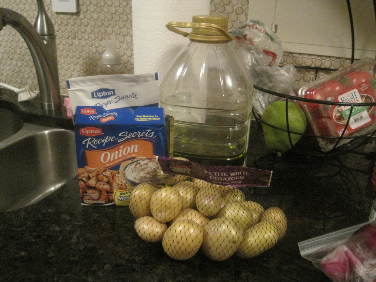 Lipton's Onion Potatoes This is the easier recipe EVER and creates amazing potatoes. It's my go to recipe. So did you know you can make delicious potatoes with that little packet of onion soup mix? I did!!! Enjoy! INGREDIENTS  1 envelope Lipton® Recipe Secrets® Onion Soup Mix 1 bag of small potatoes 1/3 cup vegetable oil  DIRECTIONS Preheat oven to 425°. Combine all ingredients in a gallon ziploc bag Mix together and pour onto foil covered baking sheet Bake, stirring occasionally, 35 minutes or until potatoes are tender and golden brown.