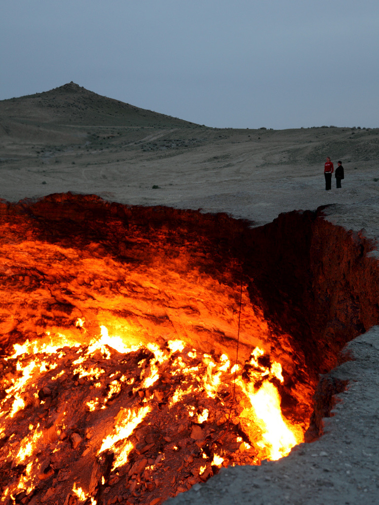 goodnamesgone:  Derweze, also known as the door to hell, is a 70 meter wide hole in the middle of the Karakum desert in Turkmenistan. The hole was formed in 1971 when a team of soviet geologists had their drilling rig collapse when they hit a cavern filled with natural gas. In an attempt to avoid poisonous discharge, they decided to burn it off, thinking that the gas would be depleted in only a few days. Derweze is still burning today