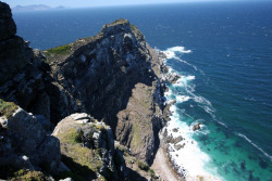 Title: The Titan of Cape Point - Photography by eCAB.  In August of 2009, I had the privilege of traveling to South Africa. On that trip, I saw many great sites, some of which I captured in pictures (more to come). I have traveled many places, but Africa is beyond special to me. This picture is of the very tip of Cape Point, SA. High winds mixed with salty air made this a truly difficult and breath taking shot. Copyright 2009