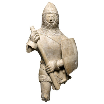 A small English statue from ca. 1350-1450. Some people have guessed that, because of the cross on the shield, the man depicted may be Saint George. The armor on the statue is an accurate representation of armor at the time, although only men from the nobility or knightly classes would have been able to afford such high-quality armor. The British Museum website has a fantastic and detailed description of each piece of armor the statue is wearing if you'd like to find out more: http://www.britishmuseum.org/explore/highlights/highlight_objects/pe/s/statue_of_a_knight.aspx