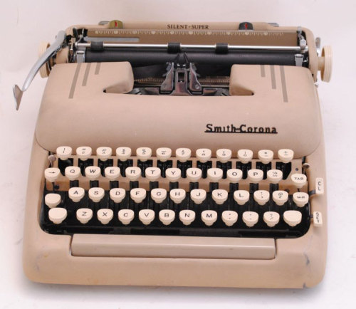 See this typewriter? I own this typewriter now. It's a Smith Corona Silent-Super from the 1950s. What. What.