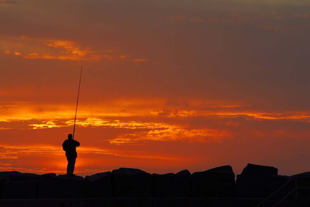 A lonely fisherman at sunset in Punta del Este, Uruguay.