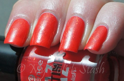 Essence Candyction - crazy neon coral flakie polish