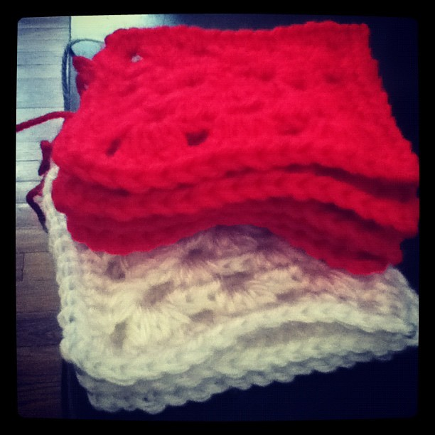 Current project: 7x7 small granny square blanket.  #granny #square #blanket #7x7 #red #white #yarn #project (Taken with instagram)