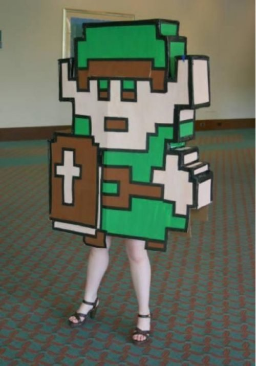 Hats off to you, Link Cosplayer. That's a unique design twist. And the dainty girl legs just make the 8-Bit body that much cooler. Thumbs Up!