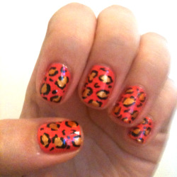 coral and gold leopard print nails