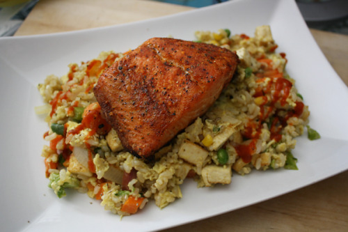 Salmon w/ Tofu Fried RiceSeasoned salmon, brown rice, eggs, extra-firm tofu, corn, peas, carrots, broccoli, cauliflower, white onions, olive oil, spicy fajita cooking sauce, S&PYesterday's yummy post-errands lunch.
