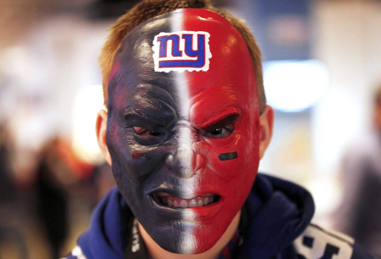 A New York Giants fan gets his game face on before the start of the NFL Super Bowl XLVI football game between the New England Patriots and the Giants in Indianapolis, Indiana, February 5, 2012. [REUTERS/Jim Young] Read more: Which Super Bowl ad got the most Twitter buzz?
