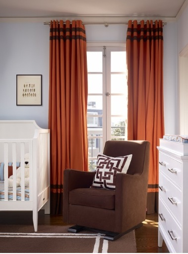 I like the orange drapes and the brown colors in this baby room. Makes me want to be married and have a baby. Follow CollegeGuyDesign if you like things like this showing up on your dash!