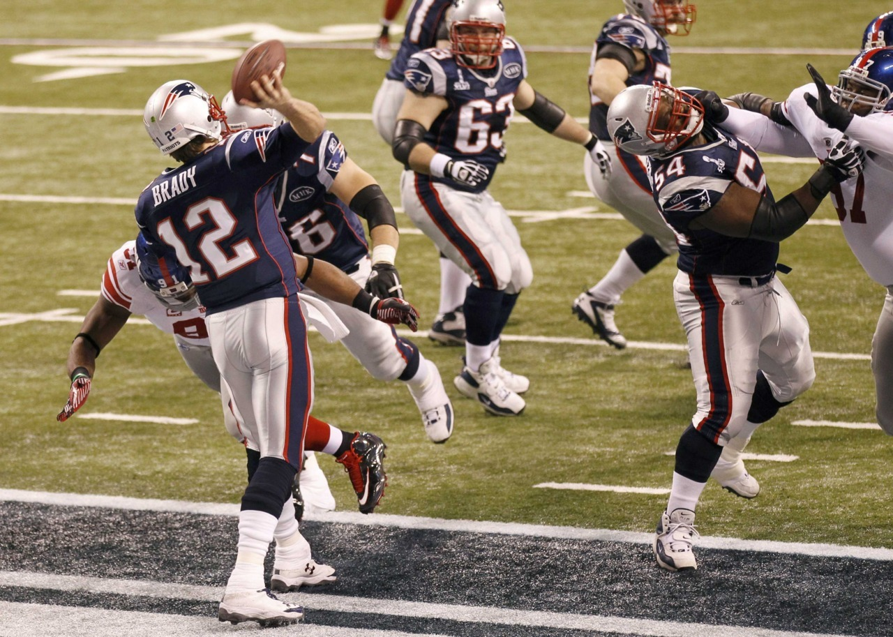 New England Patriots quarterback Tom Brady (12) is called for a safety as he throws the ball away under pressure by the New York Giants defense in the first quarter of the NFL Super Bowl XLVI football game in Indianapolis, Indiana, February 5, 2012. [REUTERS/Pierre Ducharme] Participate in the Reuters live blog during Super Bowl XLVI