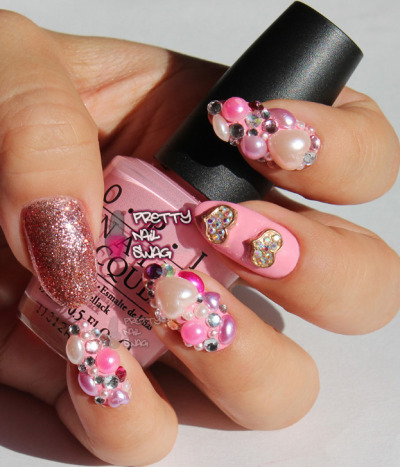 prettynailswag:  Blinged out V-day mani, OPI - Pink Friday, Milani - Disco Lights (thumb) Photo Cred: DSK  I'm such a sucker for blinged out nails!