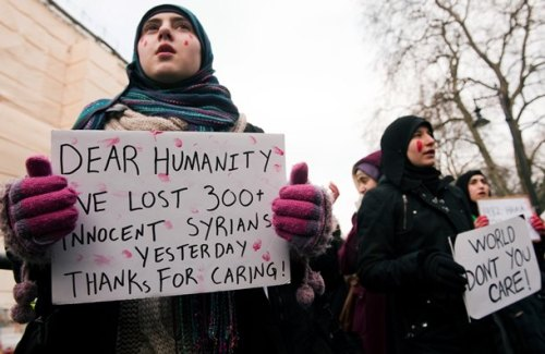 #Syria signs: Protesters outside the Syrian embassy in London.