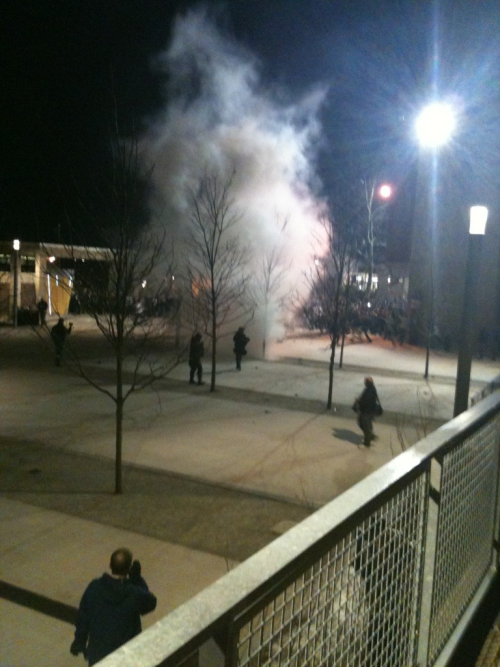 jcstearns:  Smoke bomb used by riot police at UMass Amherst to disperse crowds rioting after Patriots Super Bowl loss. Source: https://twitter.com/jcstearns/status/166371130570055680  Post-Super Bowl rioting at UMass.