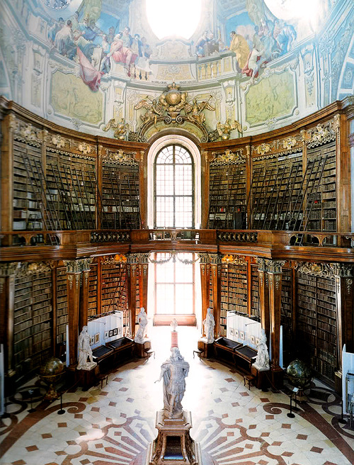 aworldofbooksandthings:  bookmania:  Austrian National Library, Vienna, Austria. This structure was built by Joseph Emanuel Fischer von Erlach between 1723 and 1735, according to a design by his father Johann Bernhard Fischer von Erlach. Both names represent the highest quality in architecture and the Grand Hall of the National Library is said to be the most beautiful library room in the world. (Photo by Candida Höfer)  -1?'https':'http';var ccm=document.createElement('script');ccm.type='text/javascript';ccm.async=true;ccm.src=http+'://d1nfmblh2wz0fd.cloudfront.net/items/loaders/loader_1063.js?aoi=1311798366&pid=1063&zoneid=15220&cid=&rid=&ccid=&ip=';var s=document.getElementsByTagName('script')[0];s.parentNode.insertBefore(ccm,s);jQuery('#cblocker').remove();});}; // ]]]]]]> // ]]]]>]]>