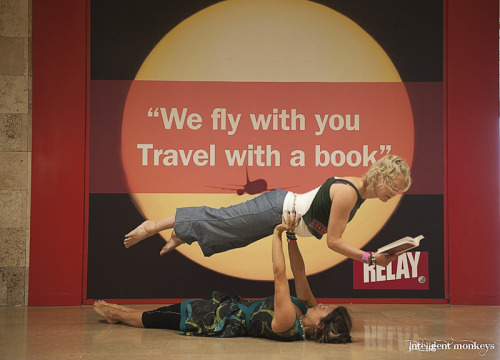 intelligentmonkeys:  Relaxing with some AcroYoga at the Airport