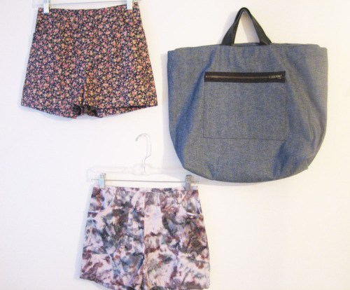 I cut up about 20 pairs of shorts last summer, to finish/make last summer, but I never did finish one pair!  I finally got back to working on them this past week and finished three.  They are lightweight cotton shorts, high waisted.  Good for hot days, summer weather.  They look better on a person versus a wall, of course!  The floral and tie dye are the left over from my bag fabrics.  And I just threw in one of the totes I made for a fun photo, i'm just gonna pin everything to my walls!