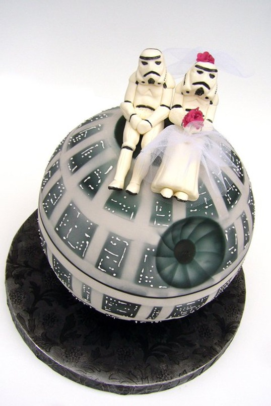 lacedinweddings:  This awesome Star Wars Wedding Cake was made by Sweet on Cake. The detail on the Death Star Cake is amazing & how much detail and time went into creating the bride & groom Stormtroopers is insane.