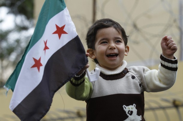 farhaaan:  Get used to it: The new Syrian flag, as demonstrated by a Syrian boy during a protest outside the Russian embassy in Tripoli yesterday. [Reuters]