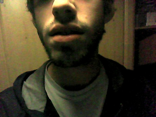 "Week and a bit of ""beard"" growth. Camera's crap but trust me, there's some patchy stubble going on there. Grown out of laziness, not on purpose. S'going byebye now. Itches."