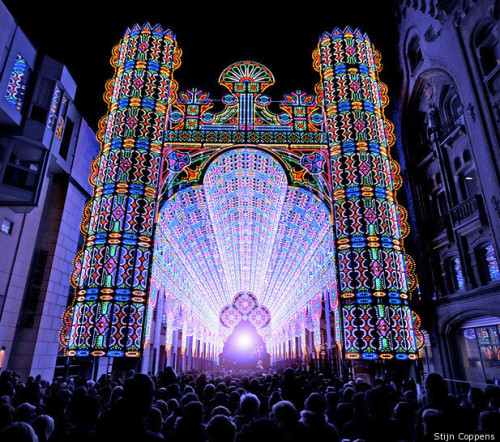 The Craziest Light Show Ever. Period. (Click for Video) Have you ever been to church and seen the light? Well at the recent Light Festival in Ghent, Belgium, the Luminarie De Cagna created an LED cathedral that lit up the entire city of Belfortstraat  with a glowing psychedelic aura. The result is arguably beautiful enough  to make anybody a believer. The LED Cathedral mixes Romanesque and Renaissance architecture with  glowing rainbow ornamentation. It stands 91 feet tall at its peak and is  made of 55,000 LED lights.