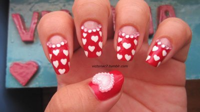 Lots of hearts! I've done this mani so many times, but you know what, I like it. Lol Colors used:  OPI - A Oui Bit Of Red