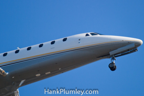 Nose Shot of a Private Jet on Approach on Flickr.Nose shot of a private jet on approach to Cleveland Hopkins International Airport, viewed through the winter trees, February 6 2012.