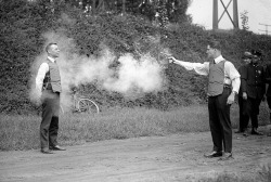 "my-ear-trumpet:  afuckingcreeper:  1923 testing of the bulletproof vest  ""Excuse me Sir, the chaps from Occupational Health and Safety would like to have a word"""