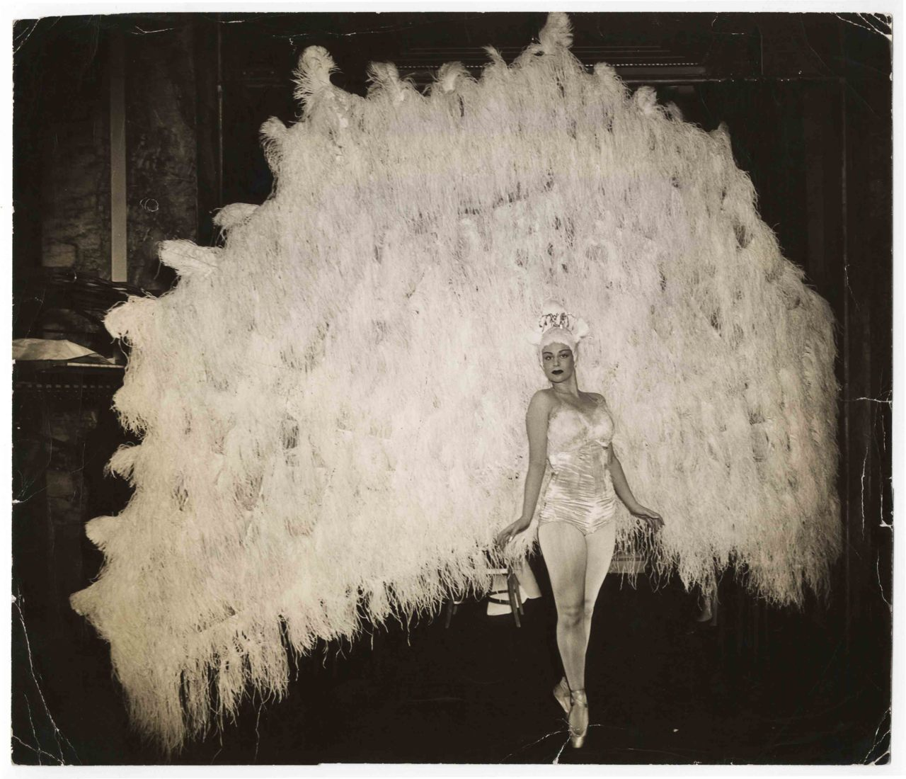 Ballerina Marina Franca in her peacock costume, April 18, 1941 photographed by Weegee