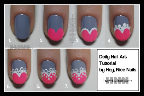 heynicenails:  Doily Nail Art Tutorial by Hey, Nice Nails We were originally going to explain how to create this nail art look by exaggerating this tutorial by the lovely ladies at Polish You Pretty, but someone asked if we would make a tutorial so we decided to give it a go! Enjoy. 1. Apply a base color. The color in the photo is Essie Cocktail Bling 2. Using a contrasting color, paint two heart shaped lobes at the tip of the nail 3. Outline the top of the heart in white 4. Use a large sized dotting tool to make white circles around the top of the heart 5. With your base color and a smaller sized dotting tool, make small dots inside the larger white dots 6. Use the smaller dotting tool and make small white dots around the inside of the heart 7. Top everything off with a good thick layer to topcoat to seal in your artwork!