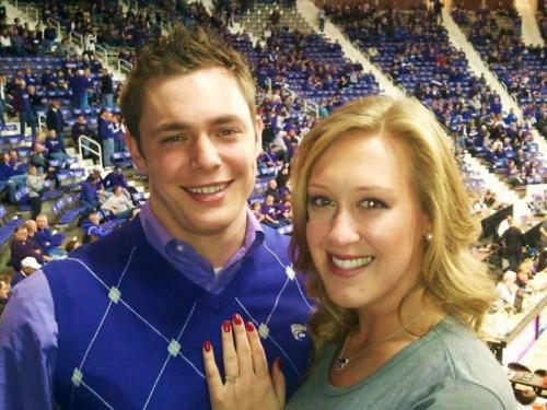 We're not sure which is more amazing… that this K-State fan pulled off the marriage proposal trick during the Kiss Cam segment on Saturday… OR, that she agreed to marry him while he was wearing that utterly ridiculous sweater vest. Memo to fiancee': Burn the vest. Please. (h/t Kansas State Collegian)