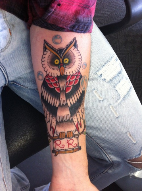 "I had my owl done on Saturday 4th of Feb. The owl is standing on a branch that has a banner with the letters ""RR"" tied to it  and bubbles floating around. This tattoo represents my 7 month old Daughter Rihley Rae, who is nicknamed ""Bubbles"". I chose the owl because her room is decorated mostly in Owls which were either made or bought for her by family and friends by coincident. Weird how the owl was actually chosen for me without me really thinking about it.  The Tattoo was done by Paul Collocott from Handstyle Tattoos in Emmerentia, Johannesburg South Africa Follow me iameffinsweet.tumblr.com"