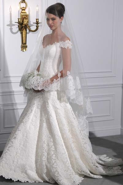 bridalguidemag:  Romona Keveza  This is exactly the dress and veil I've been picturing for months, and somehow finally seeing what it looks like in real life, I'm put off.