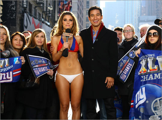 "NAMES Menounos wears Giants bikini in NYC - Medford's Maria Menounos, an ""Extra"" host and a die-hard Patriots fan, made good on her Super Bowl bet yesterday.  Photo Gallery: Menounos loses a bet"