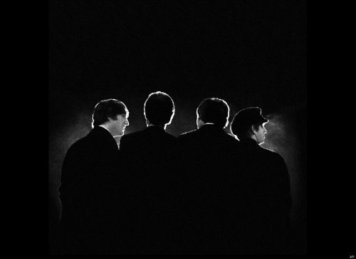 "timelightbox:  Did you know? — On this day in 1964 The Beatles arrived in New York. Photographer Mike Mitchell,  then 18 years old, shot the Beatles performing their iconic first  concert in the United States at the Washington Coliseum. The concert  occured just two days after the band's momentous performance on The Ed Sullivan Show, a debut which drew over 74 million television viewers. Looking back, Mitchell recalls,  ""to me, this concert was an  opportunity to do portraits, and to get an up close look, to really see  who these guys were! Many Americans emerging from the sleep-walking  fifties saw the Beatles as very strange creatures indeed. Most of the  establishment press treated them as mere novelty. My generation however  felt an immediate connection with them and still do.""  (see more — Beatlemania Revisited)"