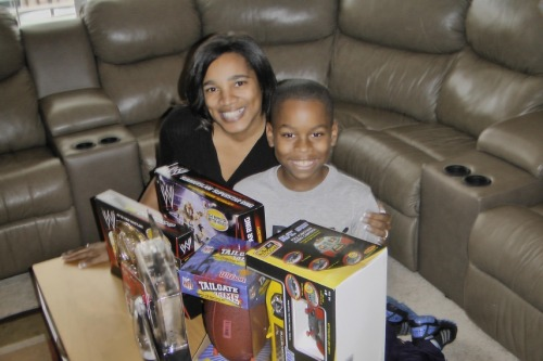 "It is better to give: Mom Shellie   decided to sponsor a family for Christmas and included her son in the   process. She said, ""this will help the next generation understand that   it is better to give than to receive."""